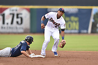 Tennessee Smokies shortstop Addison Russell #4 fields a throw as Jason Hursh #8 slides safely back into second during a game against the Mississippi Braves at Smokies Park on July 21, 2014 in Kodak, Tennessee. The Braves defeated the Smokies 4-3. (Tony Farlow/Four Seam Images)