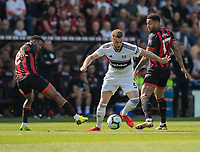 Fulham's Calum Chambers (centre) under pressure from Bournemouth's Jefferson Lerma (left) and Joshua King (right) <br /> <br /> Photographer David Horton/CameraSport<br /> <br /> The Premier League - Bournemouth v Fulham - Saturday 20th April 2019 - Vitality Stadium - Bournemouth<br /> <br /> World Copyright © 2019 CameraSport. All rights reserved. 43 Linden Ave. Countesthorpe. Leicester. England. LE8 5PG - Tel: +44 (0) 116 277 4147 - admin@camerasport.com - www.camerasport.com