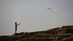 A boy flies a kite in the Jamtoli Refugee Camp near Cox's Bazar, Bangladesh. More than 600,000 Rohingya refugees have fled government-sanctioned violence in Myanmar for safety in this and other camps in Bangladesh.