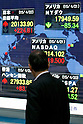 A man looks at the stock market indicator board on April 22, 2015, Tokyo, Japan. The Japan stock market broke 20,000 yen during the morning trading session of the Tokyo Stock Exchange. (Photo by Rodrigo Reyes Marin/AFLO)