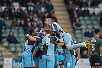 Gozie Ugwu of Wycombe Wanderers is mobbed after scoring his side's first goal during the Sky Bet League 2 match between Plymouth Argyle and Wycombe Wanderers at Home Park, Plymouth, England on 30 January 2016. Photo by Mark  Hawkins / PRiME Media Images.