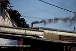 21 May 2019, Klagen Tropodo, East Java, Indonesia: Black toxic smoke pours from a chimney at a factory producing tofu at Klagen Tropodo village outside Surabaya, Indonesia. Millions of tonnes of recyclable plastic trash from Australia and Europe is dumped for rag pickers to separate and sort. The plastics are used to fuel fires at local tofu factories among other industries. Australia is illegally sending non recyclable trash hidden within this lode and the Indonesian Government is cracking down on the practice and preparing to refuse to take Australia's rubbish that is creating environmental and health issues locally. Picture by Graham Crouch/The Australian