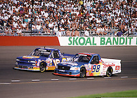 Nov. 1, 1997; Avondale, AZ, USA; NASCAR Craftsman Truck Series driver Kenny Irwin (98) races alongside Steve Park (76) during the GM Goodwrench/Delco 300 at Phoenix International Raceway. Mandatory Credit: Mark J. Rebilas-
