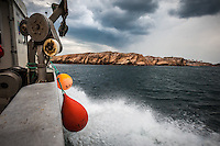 Onboard Smögen-based fisherman Martin Olofsson's fishing boat as it sails past rocky islands in the outer archipelago.