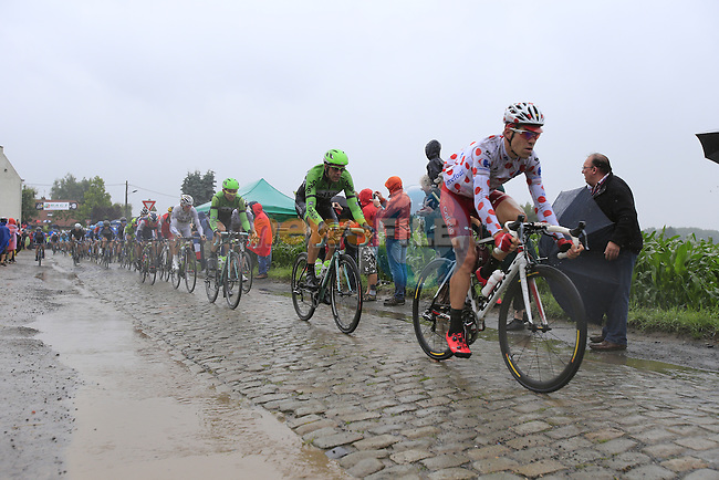 Riders including Cyril Lemoine (FRA) Cofidis tackle the1st cobbled sector 9 from Gruson to Crossroads de l'Arbe during Stage 5 of the 2014 Tour de France running 155.5km from Ypres to Arenberg. 9th July 2014.<br /> Picture: Eoin Clarke www.newsfile.ie
