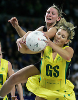 18.07.2007 Silver Ferns Casey Williams and Australia Catherine Cox in action during the Silver Ferns v Australia Fisher and Paykel Netball Test Match at Vector Arena, Auckland. Mandatory Photo Credit ©Michael Bradley.