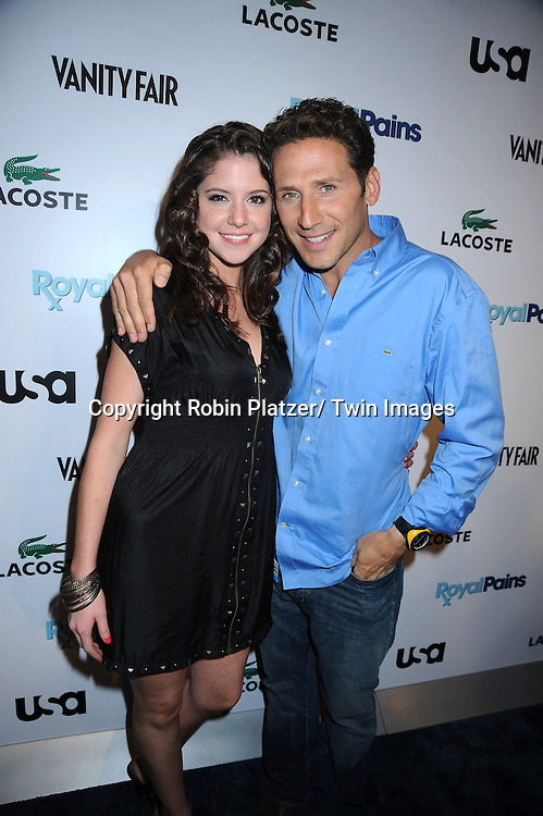 "Brittany Underwood and Mark Feuerstein posing at the USA Network and Vanity Fair celebration for the Second Season of  ""Royal Pains"".at Lacoste Fifth Avenue Store on June 1, 2010 in New York City."