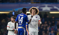 David Luiz of Paris Saint-Germain & Bertrand Traore of Chelsea on the final whistle during the UEFA Champions League Round of 16 2nd leg match between Chelsea and PSG at Stamford Bridge, London, England on 9 March 2016. Photo by Andy Rowland.