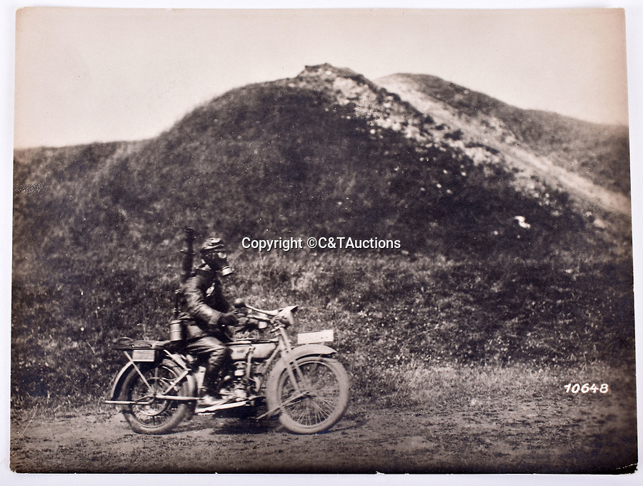 Bmth News (01202 558833)<br /> Picture:  C&TAuctions/BNPS<br /> <br /> Hot work - German despatch rider wearing gas mask.<br /> <br /> Remarkable photographs revealing how the Germans used captured British tanks against us because theirs were no good have come to light over 100 years later.<br /> <br /> The British were the first to invent the tank in 1916 and a year later used them to overwhelm the enemy at the Battle of Cambrai in the First World War.<br /> <br /> Although the battle was a success for the British, the Germans captured several Mark IV tanks.<br /> <br /> Now black and white photos have emerged to show the German high command inspecting one the hulking machines in Berlin in 1918.<br /> <br /> Other pictures in the album depicts the early days of aerial warfare when hand grenades were dropped over the side of the cockpits by German pilots.