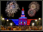 It's easy to photograph fireworks in the sky. The key to a better image is a well let foreground. The moving crowd adds even more depth.