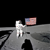 """Astronaut Alan B. Shepard Jr., Apollo 14 Commander, stands by the U.S. flag on the lunar Fra Mauro Highlands during the early moments of the first extravehicular activity (EVA-1) of the Apollo 14 mission on February 5, 1971. Shadows of the Lunar Module """"Antares"""", astronaut Edgar D. Mitchell, Lunar Module pilot, and the erectable S-band Antenna surround the scene of the third American flag planting to be performed on the lunar surface.<br /> Mandatory Credit: Edgar D. Mitchell / NASA via CNP"""