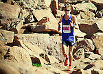 August 15, 2015 - Manitou Springs, Colorado, U.S. - Boulder, Colorado runner, Andy Wacker, carefully negotiates the final rocky steps to finish second in the Pikes Peak Ascent in a time of 2:18:36 during the 60th running of the Pikes Peak Ascent and Marathon.  During the Ascent, runners cover 13.3 miles and gain more than 7815 feet (2382m) by the time they reach the 14,115ft (4302m) summit.  On the second day of race weekend, 800 marathoners will make the round trip and cover 26.6 miles of high altitude and very difficult terrain in Pike National Forest, Manitou Springs, CO.