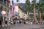 Tourists walking next to gift shops along the Promenade, Avalon, Catalina Island, California