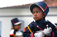 Everton da Silva, 5, marches with musicians from a number of local marching bands perform in the central square of Ouro Preto (circumflex over the e in Preto), Brazil, in celebration of the country's 1822 independence from Portugal. The city was the center of a 1789 republican conspiracy, the leader of which was beheaded. His head was displayed on a pike where the momument at rear now stands. Brazil's interior state of Minas Gerais, once a colonial mining capitol for the Portuguese crown, has changed little in appearance since the 18th century. With the help of laws to preserve its baroque architecture, the state's sky is scraped at every turn by 250-year-old church steeples, and lined with cobblestones. (Kevin Moloney for the New York Times)
