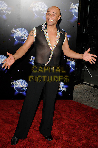 GOLDIE (Clifford Joseph Price).At the Strictly Come Dancing Launch Show TV recording, London, England, UK, September 8th 2010..full length black sleeveless sheer mesh see thru through shirt costume trousers hands gold sequined sequin sparkly .CAP/CAN.©Can Nguyen/Capital Pictures.