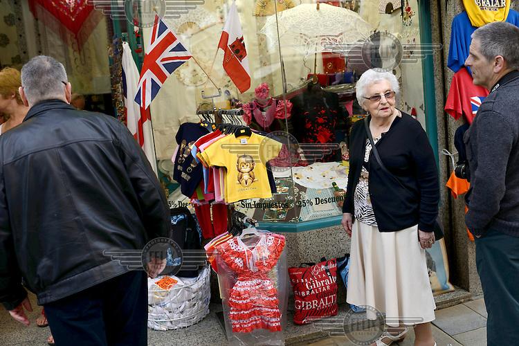 Tourist outside a souvenir shop.