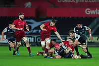 Sam Cross of Ospreys is tackled by Chris Cloete of Munster during the Guinness Pro14 Round 16 match between Ospreys and Munster Rugby at the Liberty Stadium in Swansea, Wales, UK. Friday 22 February 2019