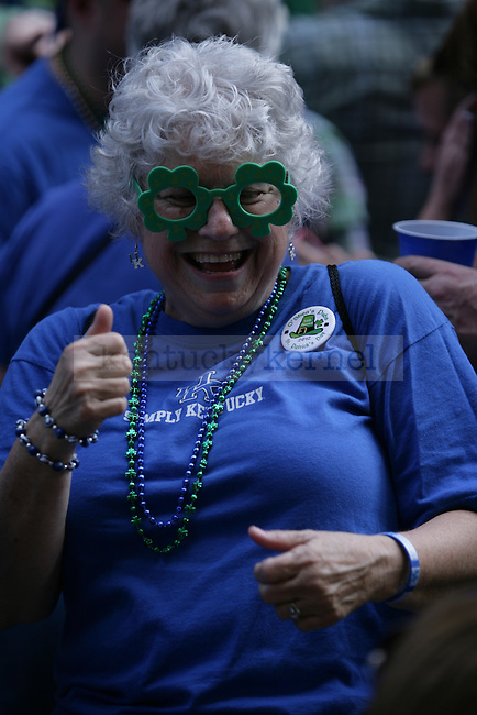 a Kentucky fun wears shamrock glasses and dances to music during the pre-game pep rally near the KFC Yum! Center, March 17, 2012 in Louisville Ky. Photo by Brandon Goodwin | Staff