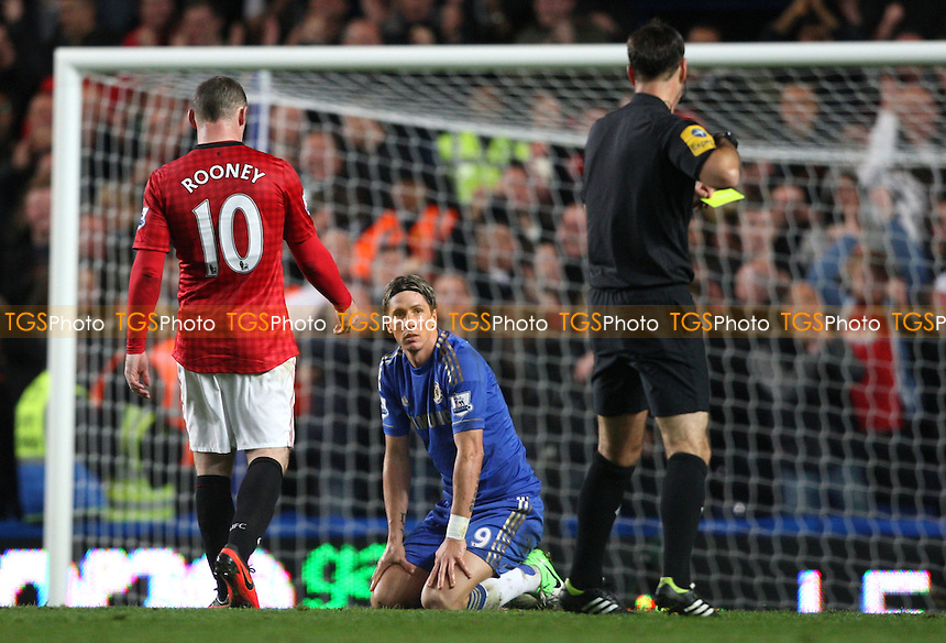 Fernando Torres of Chelsea is shown a red card by referee Mark Clattenburg - Chelsea v Manchester United, Barclays Premier League at Stamford Bridge, Chelsea - 28/10/12 - MANDATORY CREDIT: Rob Newell/TGSPHOTO - Self billing applies where appropriate - 0845 094 6026 - contact@tgsphoto.co.uk - NO UNPAID USE.