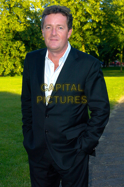 "PIERS MORGAN.Attends journalist and former Vanity Fair editor Tina Brown's Book Launch Party for ""The Diana Chronicles"", a biography of The Princess Of Wales, held at The Serpentine Gallery,.London, England, June 18th 2007..half length black suit white shirt.CAP/CAN.©Can Nguyen/Capital Pictures"