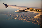CHICAGO, IL -- AUGUST 13, 2015:  The wing tip of an Airbus A319 flies over Chicago, early Thursday morning, August 13, 2015.  PHOTOGRAPH BY MICHAEL NAGLE