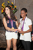 Aly Raisman and Gabby Douglas of The gold medal-winning US Women's Gymnastics Team, the 'Fierce 5', flip the switch and light the Empire State Building's world-famous tower lights red, white and blue in honor of Team USA's success at the 2012 Olympic Game  in London. New York City, August 14, 2012. © Diego Corredor/MediaPunch Inc. /NortePhoto.com<br />