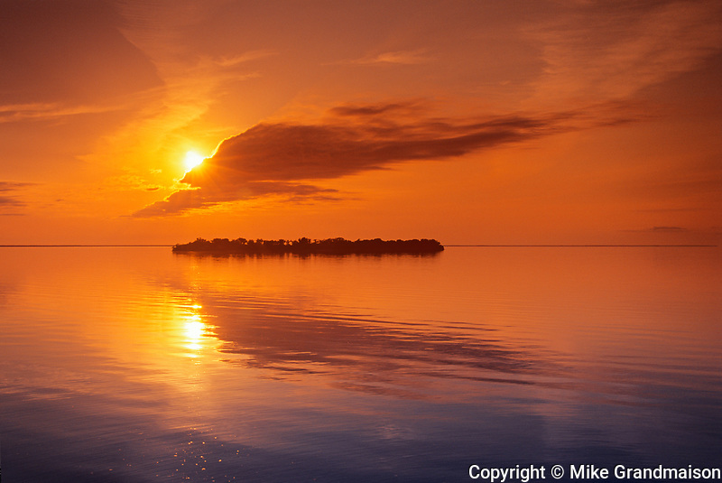 Island reflected in Lake Manitoba st sunset, Steeprock, Manitoba, Canada
