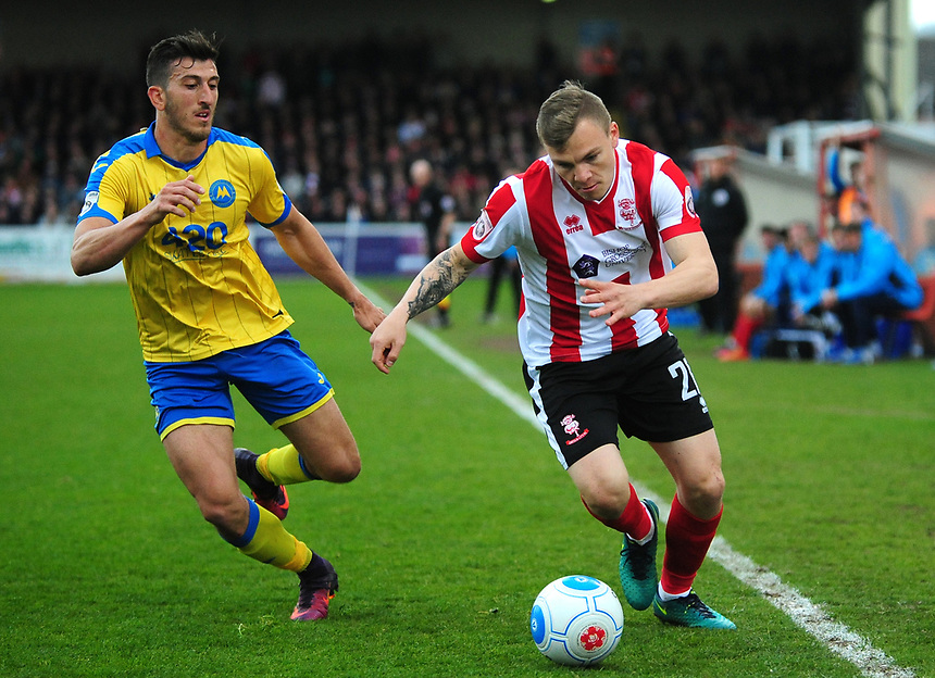 Lincoln City's Harry Anderson vies for possession with Torquay United's Giancarlo Gallifuoco<br /> <br /> Photographer Andrew Vaughan/CameraSport<br /> <br /> Vanarama National League - Lincoln City v Torquay United - Friday 14th April 2016  - Sincil Bank - Lincoln<br /> <br /> World Copyright &copy; 2017 CameraSport. All rights reserved. 43 Linden Ave. Countesthorpe. Leicester. England. LE8 5PG - Tel: +44 (0) 116 277 4147 - admin@camerasport.com - www.camerasport.com