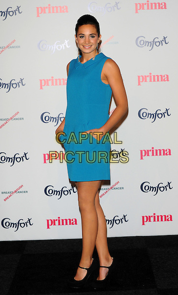 Laura Wright.Prima High Street Fashion Awards, Battersea Evolutions, Battersea Park, London, England..September 8th, 2011.full length blue sleeveless dress hands in pockets .CAP/CJ.©Chris Joseph/Capital Pictures.