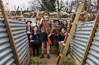 BNPS.co.uk (01202 558833)<br /> Pic: PhilYeomans/BNPS<br /> <br /> Fix Bayonets! - Students of Garth Hill College in Bracknell get used to life in the trenches.<br /> <br /> Class War - A school has turned part of its playground into a replica First World War trench system that makes an fascinating and poignant living history classroom.<br /> <br /> The scaled down trenches allows pupils to get an authentic, hands-on lesson on what life and conditions were like for the unfortunate soldiers who served on the Western Front. <br /> <br /> As well as being given educational talks, students also get muddy taking part in re-enactment demonstrations in the trenches. <br /> <br /> The attention to detail includes replica rifles, bayonets, shell casings and even models of the ever present rats.<br /> <br /> The outdoor classroom is the first of its kind in the country and schools from miles around are booking up visits for their students to experience the real feel of the award winning movie 1917.