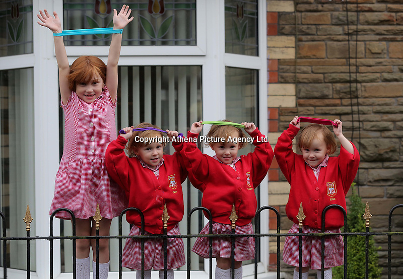 Pictured L-R: Faye Gilbert with younger triplet sisters Paige, Maddison and Ffion <br /> Re: A set of identical triplets have been colour-coded to help teachers tell them apart on their first day in nursery school.<br /> Three-year-olds Ffion, Maddison and Paige Gilbert, are so alike even their parents struggle to know which is which.<br /> Karen and Ian Gilbert used different coloured nail-varnish on their fingers and toes to identify them when they were babies.<br /> Now the couple are using the same colours for their hair bands and bobbles at the nursery where they have just enrolled.<br /> And the colours even correspond with the names of the identical trio. <br /> Ffion has fuschia, Maddison has mint and Paige has purple.<br /> Karen, 35, of Pontypool, South Wales, said: &quot;We have colour-coded them since they were tiny babies - it helped us keep track of which ones had been fed.<br /> &quot;But nail varnish isn't allowed in school so we had come up with come other way.