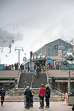 USA, Colorado, Aspen, skiers gather at the base of Aspen Mountain, Aspen Ski Resort, Ajax