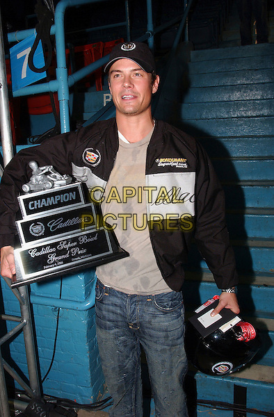 JOSH DUHAMEL.The 4th Annual Cadillac Celebrity Super Bowl Grand Prix held at the Michigan State Fairgrounds Coliseum, Detroit, Michigan, USA..February 4th, 2006.Photo: Jason Nelson/AdMedia/Capital Pictures.Ref: JN/ADM.half length black award terophy helmet baseball cap hat.www.capitalpictures.com.sales@capitalpictures.com.© Capital Pictures.