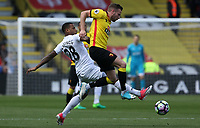 Tom Cleverley of Watford is challenged by Luciano Narsingh of Swansea City during the Premier League match between Watford and Swansea City at Vicarage Road Stadium, Watford, England, UK. Saturday 15 April 2017