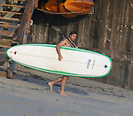 9-22-09 Exclusive.Stuart Townsend going surfing at his beach house in Malibu ca ....AbilityFilms@yahoo.com.805-427-3519.www.AbilityFilms.com