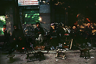 September, 1985. Shaanxi Province, China. Cycle repairs are made along the side of the street in Yan'an. Since 1976, when the Cultural Revolution ended, small traders and repairs shops have reappeared.