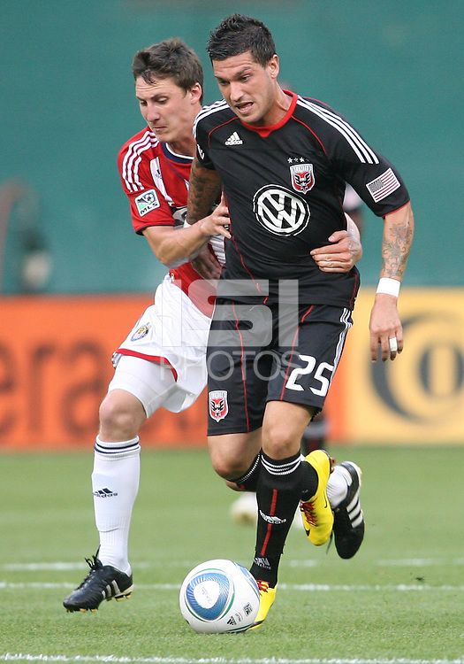 Santino Quaranta #25 of D.C. United  is grabbed by Ben Zemanski #21 of Chivas USA during an MLS match at RFK Stadium, on May 29 2010 in Washington DC. United won 3-2.