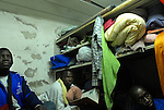 African asylum-seekers at their room, in a temporary shelter in southern Tel Aviv, Israel.