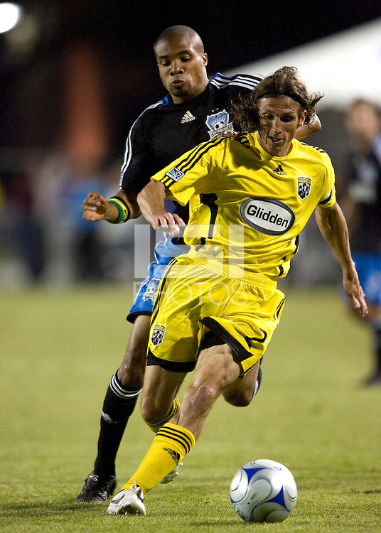 10 May 2008: Frankie Hejduk of Crew dribbles the ball away from Ryan Johnson of the Earthquakes during the game at Buck Shaw Stadium in San Jose, California.   Columbus Crew defeated San Jose Earthquakes, 3-2.