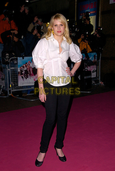 "LUCY PUNCH.The UK Film Premiere of ""St. Trinian's"" held at the Empire Leicester Square, London, England..December 10th 2007.full length white shirt black skinny jeans denim blouse hand on hip.CAP/CAN.©Can Nguyen/Capital Pictures"