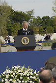 September 11, 2008 -- United States President George W. Bush speaks at the Pentagon Memorial dedication ceremony Sept. 11, 2008. The national memorial is the first to be dedicated to those killed at the Pentagon on Sept. 11, 2001. The site contains 184 inscribed memorial units honoring the 59 people aboard American Airlines Flight 77 and the 125 in the building who lost their lives that day. .Credit: Joseph Buzanowski - DoD via CNP
