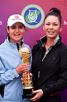HAIKOU, CHINA - OCTOBER 31:  Lorena Ochoa (L) of Mexico poses with Hollywood actress Catherine Zeta-Jones after winning the Mission Hills Start Trophy at Mission Hills Resort on October 31, 2010 in Haikou, China.  The Mission Hills Star Trophy is Asia's leading leisure liflestyle event and features Hollywood celebrities and international golf stars. Photo by Victor Fraile / studioEAST