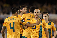 MELBOURNE, 11 JUNE 2013 - Tim CAHILL and Mark BRESCIANO of Australia celebrate after winning their Round 4 FIFA 2014 World Cup qualifier match between Australia and Jordan at Etihad Stadium, Melbourne, Australia. Photo Sydney Low for Zumapress Inc. Please visit zumapress.com for editorial licensing. *This image is NOT FOR SALE via this web site.