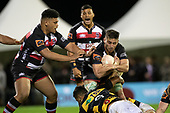 Sam Henwood gets tackled by Lachlan Boshier and Te Toiroa Tahuriorangi. Mitre 10 Cup rugby game between Counties Manukau Steelers and Taranaki Bulls, played at Navigation Homes Stadium, Pukekohe on Saturday August 10th 2019. Taranaki won the game 34 - 29 after leading 29 - 19 at halftime.<br /> Photo by Richard Spranger.