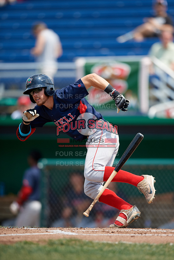 Lowell Spinners third baseman Korby Batesole (12) drops his bat on the way to first after laying down a bunt single during a game against the Batavia Muckdogs on July 15, 2018 at Dwyer Stadium in Batavia, New York.  Lowell defeated Batavia 6-2.  (Mike Janes/Four Seam Images)