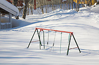 Sweden, SWE, Kiruna, 2008Mar22: A swing stuck in the snow.