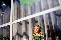 Irish-themed decorations stand in a window of a house in South Boston, Massachusetts, on the day of the St. Patrick's Day Parade.