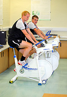 Pictured L-R: Shaun MacDonald with Scott Donnelly on the static bikes<br /> Re: Swansea City FC footballers take fitness test at Swansea University Sports Science department<br /> Picture by D Legakis Photography/Athena Picture Agency, Swansea, 07815441513