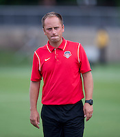 Washington Spirit head coach Mark Parsons watches his team before the game at the Maryland SoccerPlex in Boyds, MD. The Washington Spirit tied FC Kansas City, 1-1.