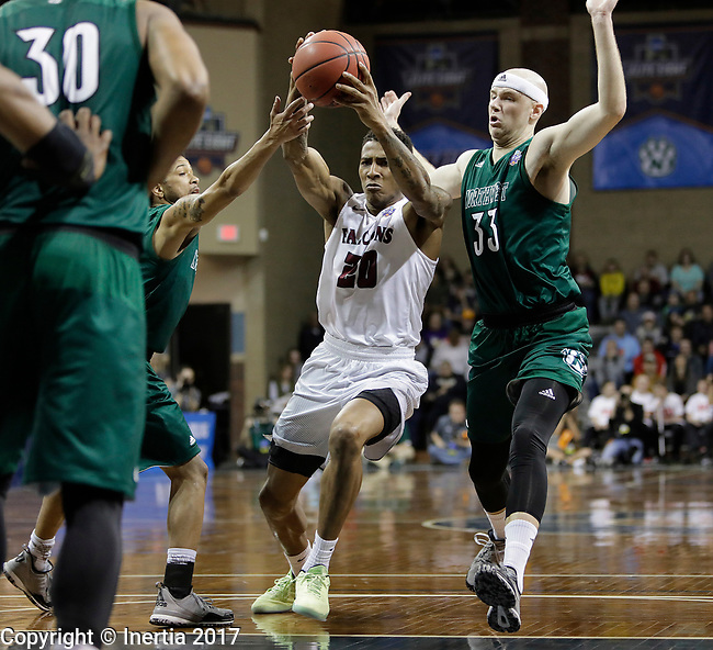 SIOUX FALLS, SD: MARCH 25:  Thomas Wimbush #20 of Fairmont State drives on Zach Schneider #33 of Northwest Missouri State during the Men's Division II Basketball Championship game on March 25, 2017 at the Denny Sanford Premier Center in Sioux Falls, SD. (Photo by Dick Carlson/Inertia)